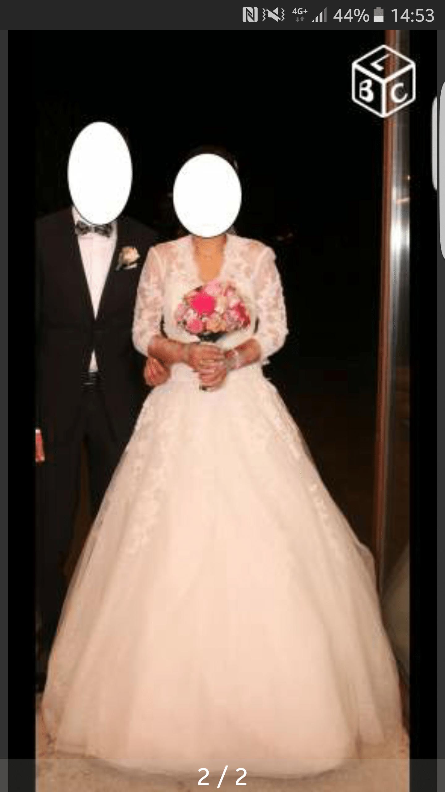 Robe de mariée avec manches en dentelles