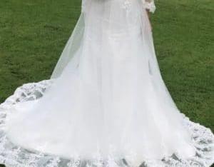 Robe de mariée à traine et voilette